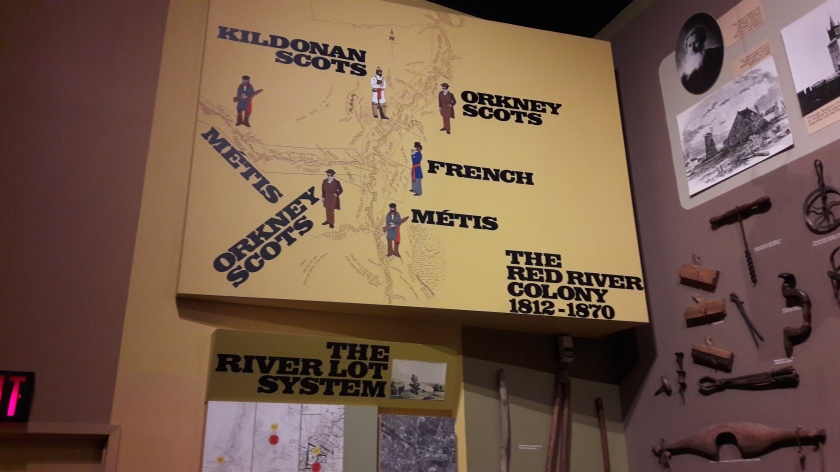 A map of the Red River Colony, showing the positions of Kildonan Scots, Orkney Scots, French and Métis. Right, a display of 19th century agricultural tools.